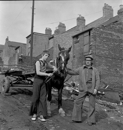 Horse and cart, Newcastle upon Tyne 1970s. This photograph is from the Robert Hope collection. Robert Hope was a resident of Newcastle upon Tyne. In the early 1970s he took out a bank loan to buy a Rolleiflex camera. Over the next few years he photographed various Newcastle scenes, including the Grainger Market and the demolition of housing estates in the West End of the city. Robert Hope died in 2001.