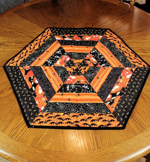 Hexagon Halloween Table Runner Quilt Skeletons <> This runner is just plain FUN! This fabric is full of skeletons, spider webs, bats, pumpkins and more. All in black, orange and white.