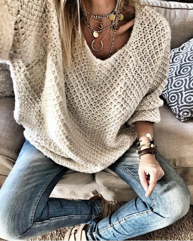 Beige top, skinny jeans, layered silver necklaces & bracelets, watch with a brow…