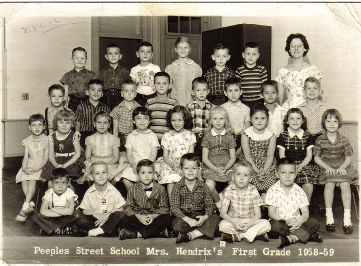 My 1st grade. 3rd from the left rear