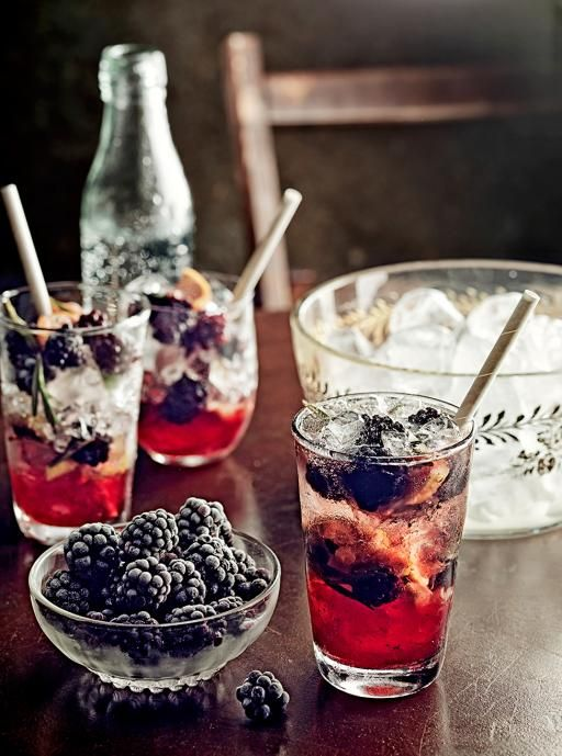 Berry and Rosemary Gin Fizz  500g frozen blackberries 4 chopped lemons 2 sprigs of rosemary 10 juniper berries 5tbsp honey 500ml gin 1l soda water  Divide the berries, lemon & rosemary with 1/2 tbsp honey into glasses. Mash the mixture with a muddler until crushed, fill with ice, top with 50ml gin and a dash of soda water. Perfecto!