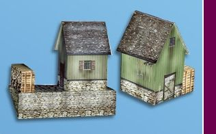 Marklin start up 	 Alpine huts with wood stacks (H0)