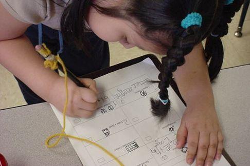 Kindergarten student making her learning plan.