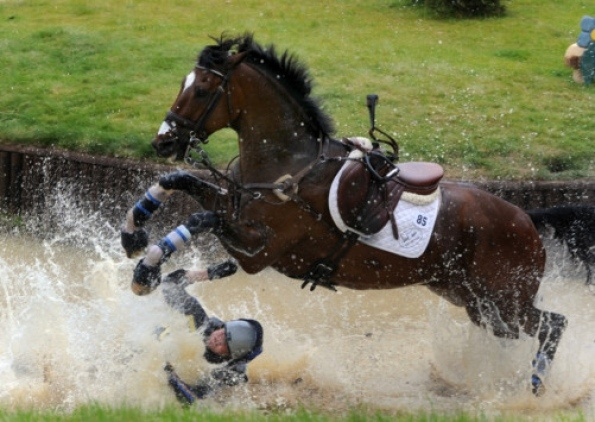 4th June 2011. Welcome To Yorkshire Bramham International Horse Trials. Pictured USA rider Julian Stiller riding Enjot Me, takes a tumble at Dickinson Dees Beachside water jumps during the CCI Cross Country Picture by Gerard Binks.