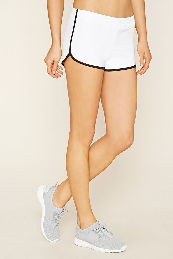 A pair of dolphin shorts crafted from knit with contrast trim and an elasticized waist.
