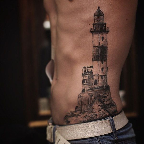 Light house - Light house tattoos are not very common, it has different meanings. The purpose of the lighthouse is to signal ships that the coast is near or is guiding light that the sailors are almost to land. #TattooModels #tattoo