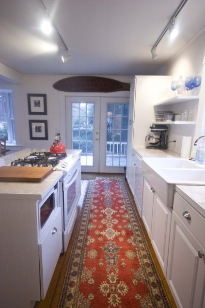 Open galley stove in the island with extra island on the for Open galley kitchen with island