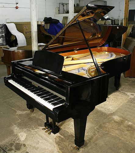 A 1969, A Bluthner concert grand piano with a polished, black case at Besbrode Pianos
