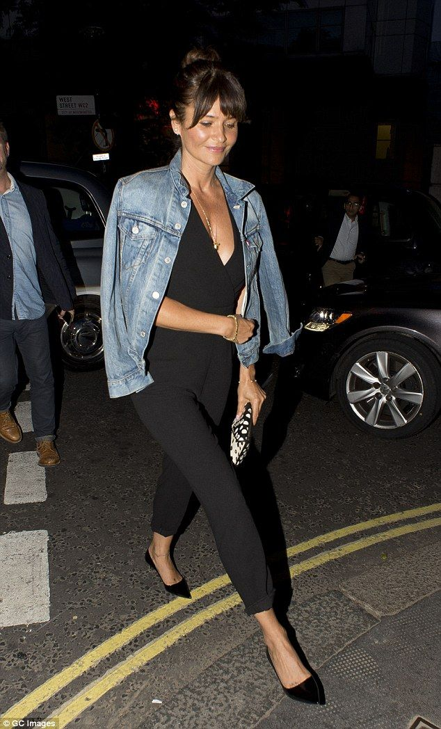 Co-ordinated: Looking stylish in her choice of attire, the star - who once dated Michael Hutchence, following his relationship with Kylie Minogue - added a pair of patent leather flats and a polka dot clutch bag to the mix