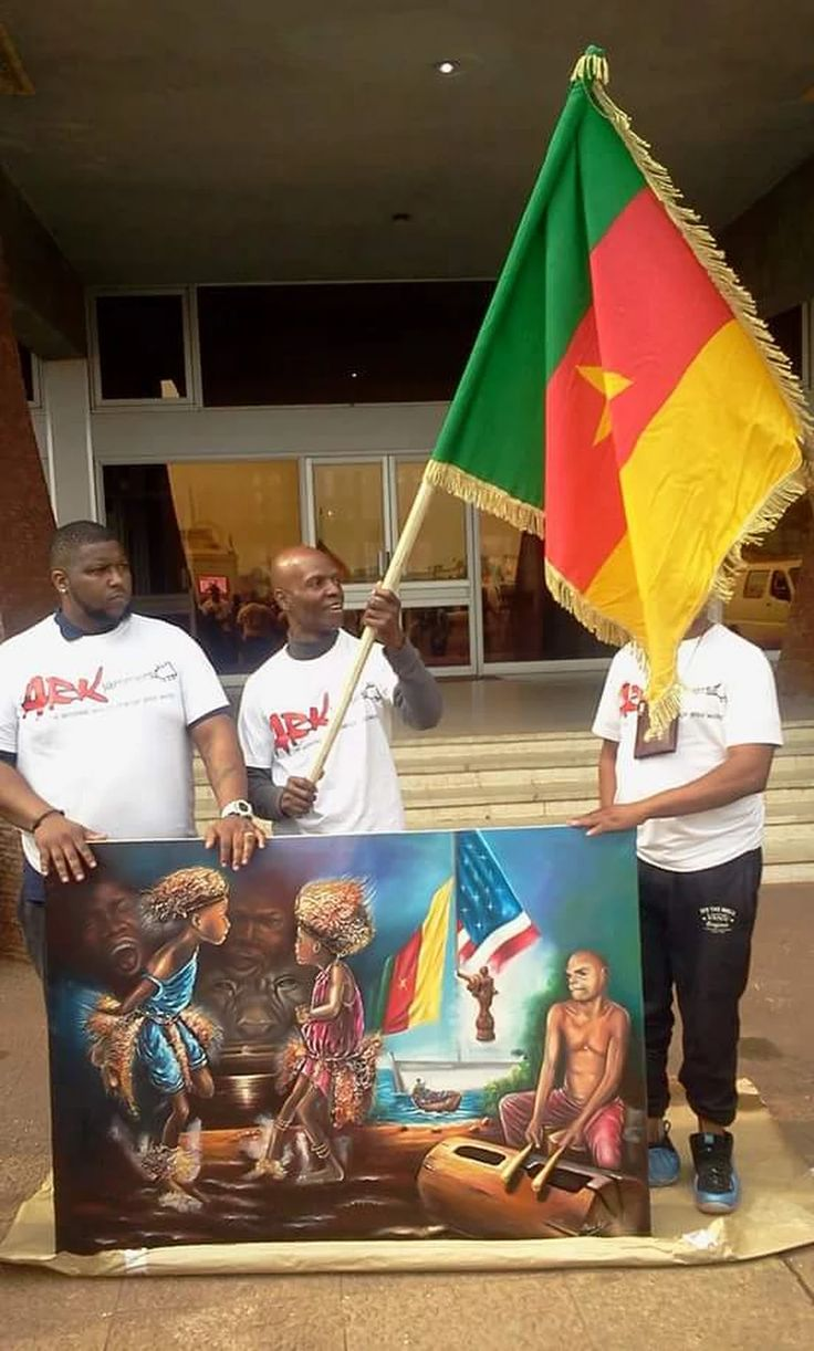 End of Limbe and Kribi site evaluation with a surprise gift from ARK Jammers to the MOH team. A paint by ARK Jammers artist Élysée Mebo'o...Nijel Binns holding the Cameroonian flag.