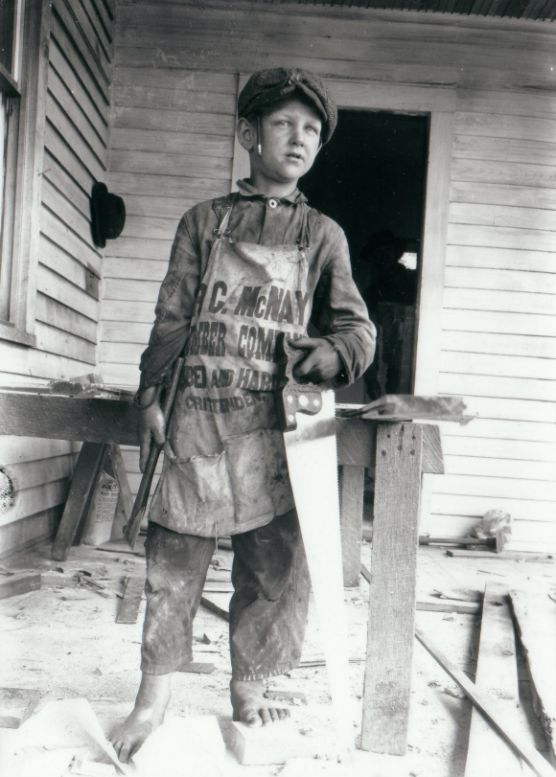 Boy with McNay Lumber Apron, Crittenden, Kentucky