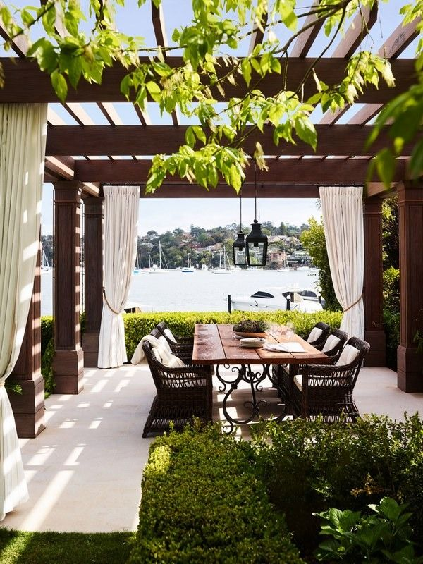 The new alfresco dining pavilion provides a front row-seat to harbor views. Janus et Cie chairs pull up to a table custom designed by Thomas Hamel and fabricated by Beebo Constructions   archdigest.com