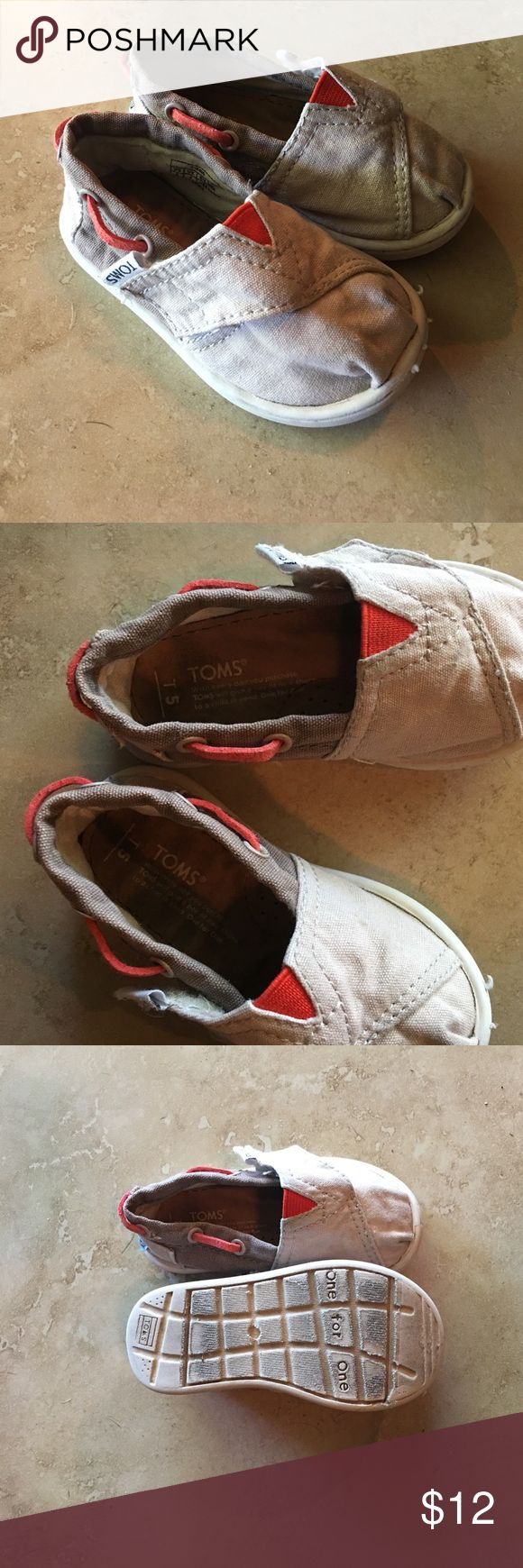 Tiny Toms T5 gray, brown and orange shoes Tiny Toms size T5 gray and brown shoes with orange leather wrapped around the top and orange elastic. In Good condition only light wear. Toms Shoes Baby & Walker