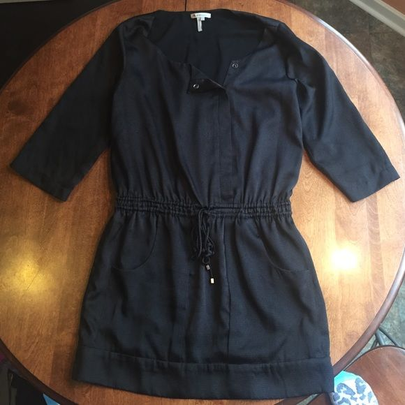 Black BCBG Dress Great black BCBG dress with pockets, ties at the waste, sleeves roll up and hidden buttons down the front.  Only worn twice! BCBG Dresses Long Sleeve