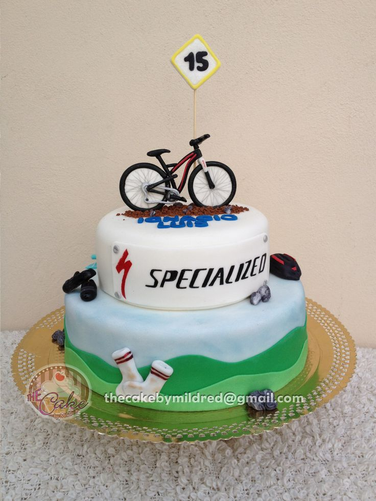 I made this 2 tiered cake for my godson. He is a mountain bike fan. I made the topper like his own bike and made some accents like helmet, dirty socks (my hubby is mountain bike fan as well and his socks always have dirty stains), shoes and cooler - Repostería - Puerto Ordaz - Venezuelaa
