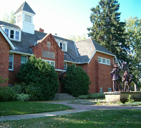 The Multicultural Centre, Stony Plain, Alberta  - built in 1925; once a high school, it now houses a historical library & archives, museum, and a craft shop  - during the reno's downstairs in the kitchen, workers reported that tools and objects would move on their own  - the spirit of a woman dressed in turn-of-the-century clothing is seen  - stools are stacked on tables at night when no one's around  - white, misty figures are reported in the main building