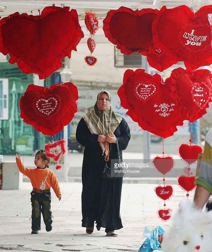 An Iraqi woman looks at the display of gifts for Valentine's Day gifts on sale February 14, 2006 in Baghdad, Iraq. Despite the continuous violence, Iraqis are celebrating St. Valentine Day in Baghdad. (Photo by Wathiq Khuzaie /Getty Images).