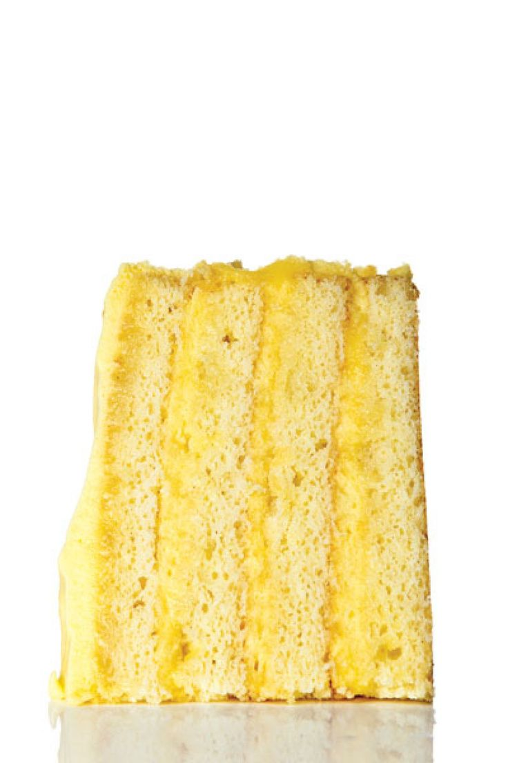 Lemon infuses this layered masterpiece in three ways: zested into the batter, in a tart syrup that get drizzled over the cakes, and in a thick lemon curd frosting.