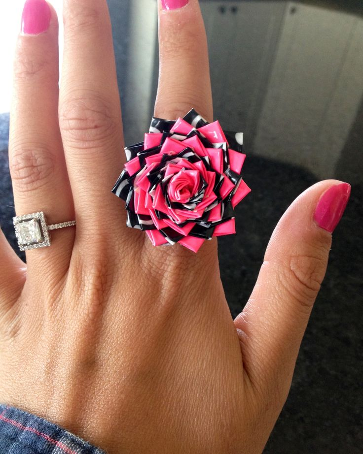 Duck Tape ring. This little beauty took forever to make, you can't tell but the black tape is Batman. Now which ring looks better? :)