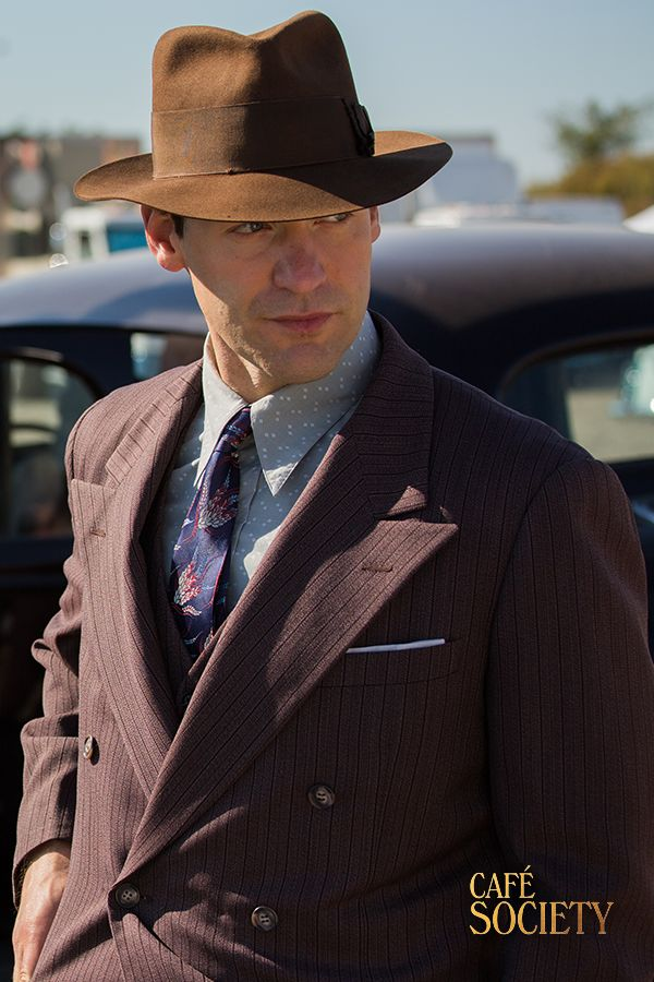 """""""If you ask politely, people listen"""" Looking ever so cool in a Fedora hat, Bobby's (Jesse Eisenberg) big brother Ben, played by Corey Stoll has a way of getting what he wants! Opening up the hottest nightclub, this smooth wiseguy entertains politicians, socialites and movies stars under one roof in 1930's glitzy New York City! Café Society is in cinemas September 2"""