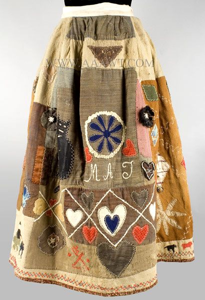 Applique Story Skirt In the manner of Harriet Powers. Assembled from early to mid 19th C. scraps of homespun wool, prints, yarn and more, all hand sewn, this Story Skirt is reminiscent of the wonderful African American Quilts made by Harriet Powers in the late 19th Century