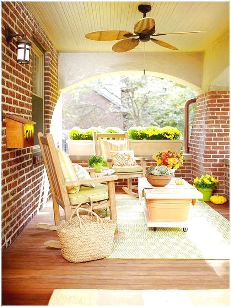 SIMPLE WAY TO PERFECT PORCH EASILY WITH DECORATION SOFA TWO WOODEN CHAIRS NEAR THE WALLS OF THE HOUSE