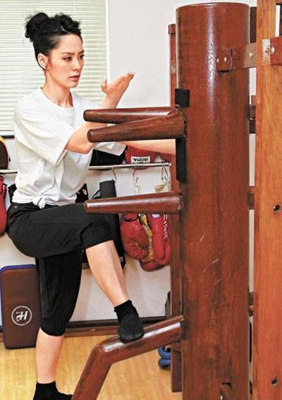 Wing Chun, working the wooden dummy.