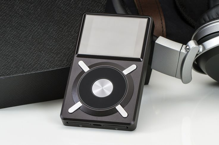 """FiiO X5 Audiophile Music Player - Massdrop.  the X5 is packed with processing power and audio optimizers. The computing is handled by an Ingenics 4760B dual-core 600 MHz CPU, which reads and writes at about 4.5 M/sec. It supports nearly every lossless file type and is easily accessible through the customizable user interface, displayed by a 2.4"""" IPS color LCD and navigated with the mechanical scroll wheel."""