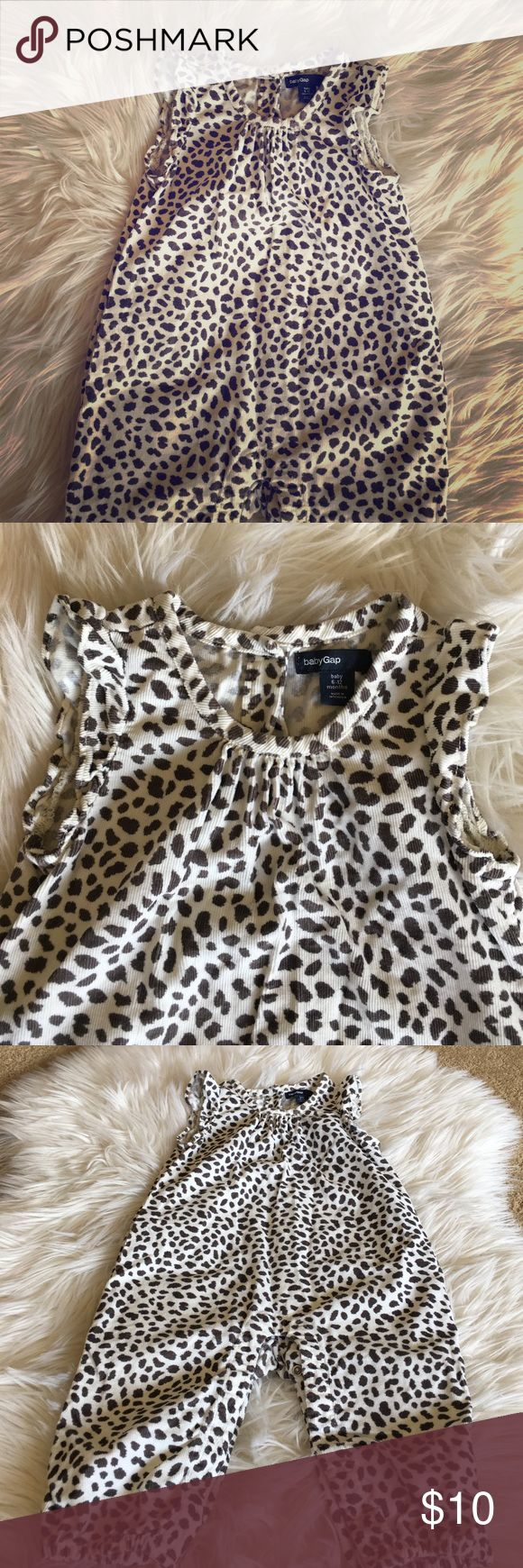 Baby Gap baby wale corduroy one piece 6-12 M Adorable little animal print one piece with cap flutter sleeve, pleating detail at neck. 3 button closure at back & snap legs. Elasticized leg bottoms. The animal print is kind of a brownish gray color on ivory. EUC baby gap One Pieces