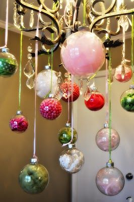 DIY party decor idea: Fill glass ornaments with different items and hang from chandelier! Simple and sweet!