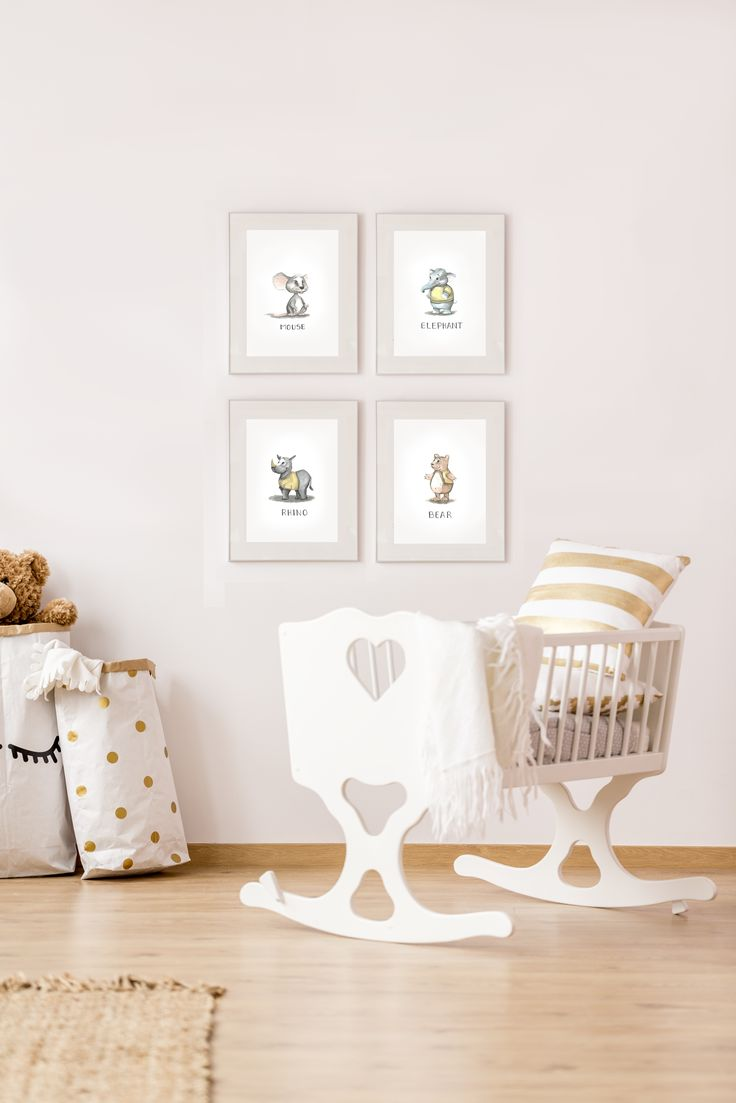 nursery decor. beige interior design. beige decorations. baby room. animal illustrations. watercolor illustrations.