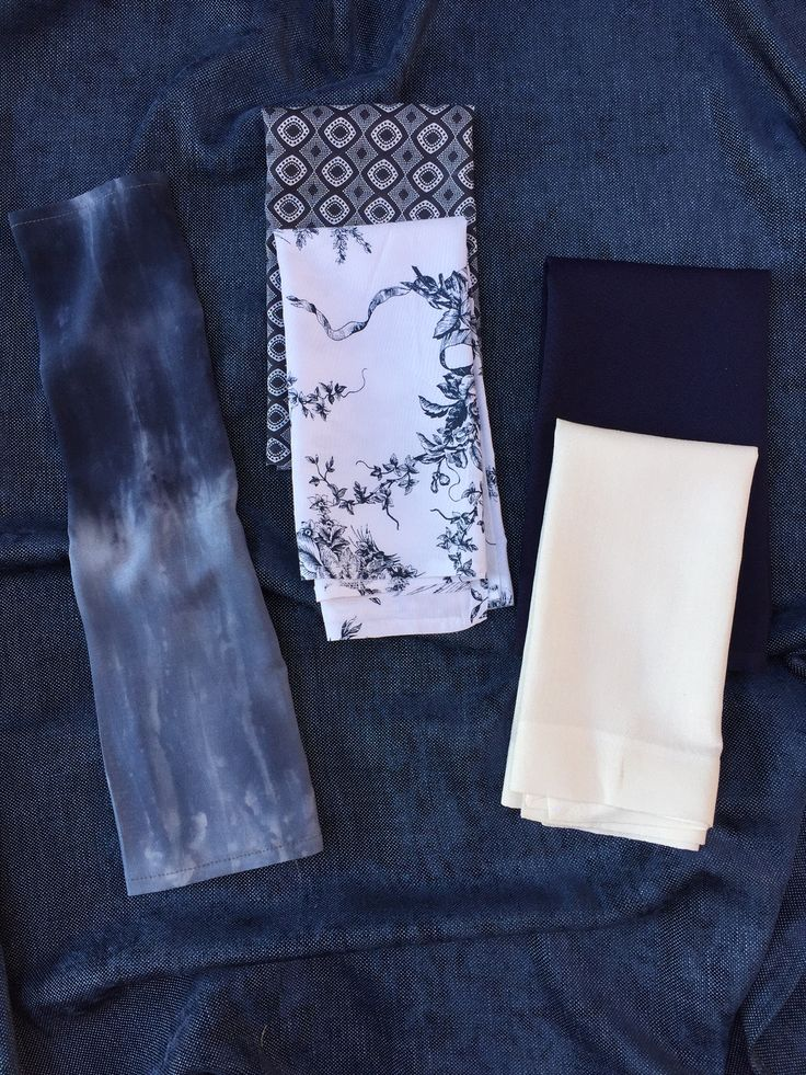 Beautiful navy textured linen cloth with a variety of stunning napkins...indigo, toile, shwe shwe, navy and white linen