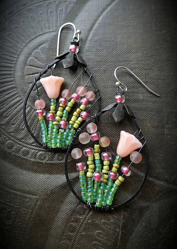 100 % Artisan Made; wire wrapped glass flowers , rounds of matte agate and a seed bead mix to form a bursting garden, finished off with sterling silver ear wires • very light weight!!!!!!!!!!!!!! • never to be duplicated exactly • totally unique • 100% ARTISAN HANDMADE!! • Yucca Bloom original