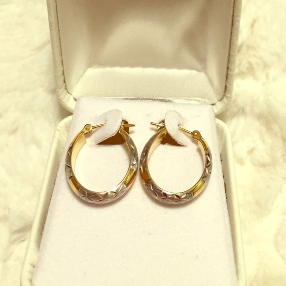 Gold and Sterling Silver Hoop Earrings Beautiful gold and silver oval hoop earrings with diamond cutting on edge.  Very versatile. New without tags, but in original box. Sterling Jewelers Jewelry Earrings