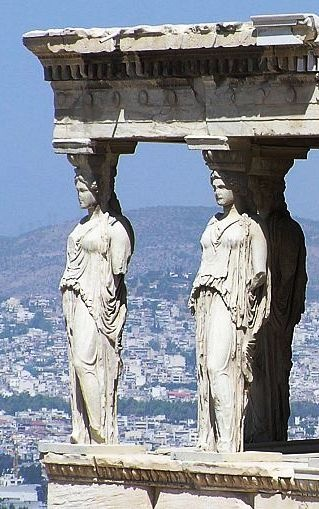 Caryatid Porch of the Erechtheion on the Acropolis at Athens. A caryatid is a sculpted female figure serving as an architectural support taking the place of a column or a pillar supporting an entablature on her head. One of those original six figures, removed by Lord Elgin in the early 19th century, is now in the British Museum in London. The Acropolis Museum holds the other five figures, which are replaced onsite by replicas.