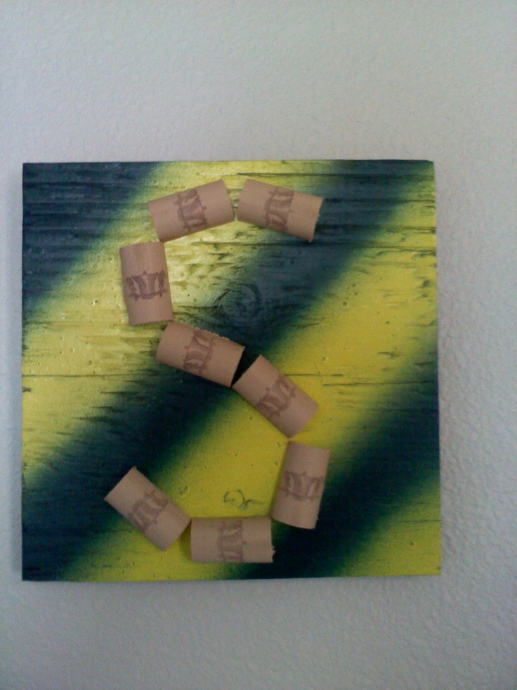 We have lots of wine corks around the house, so I cut them in half lengthwise and glued them on plywood I painted. I've made a few for friends with the initial or their last name or their full last name if it is short enough.