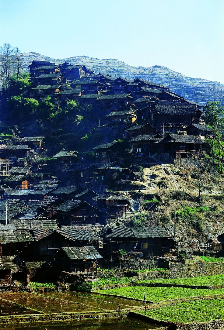 "In the mountainous regions of southern China, villages and towns are often built vertically, tier upon tier climbing up the hillsides to form a picturesque view. These are vernacular dwellings in Qianjiazhai in Xijiang District, a hilly village where buildings are constructed upon each other. From ""Vernacular Architecture,"" a volume of the Library of Ancient Chinese Architecture."