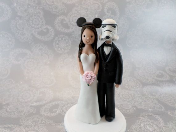 Get creative with your cake topper. | 33 Subtle Ways To Add Your Love Of Disney To Your Wedding