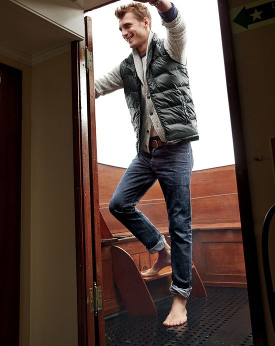DEC '14 Style Guide: J.Crew men's lightweight puffer vest, Italian shawl-collar cardigan sweater, and resin crinkle wash jeans.