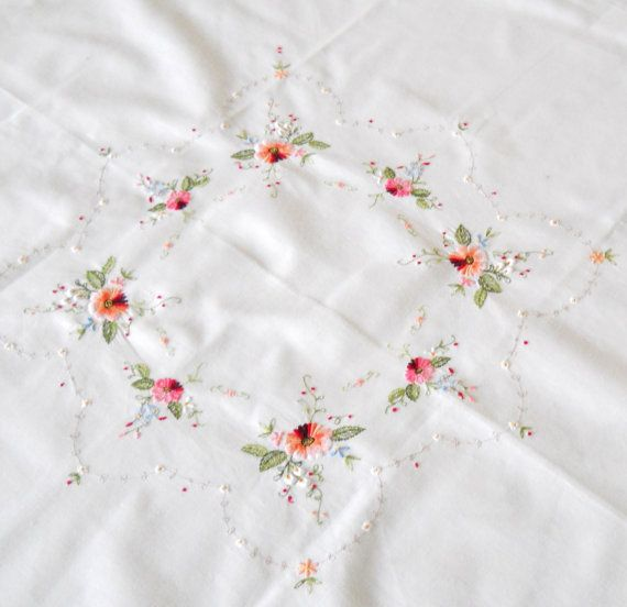 Lovely vintage tablecloth embroidered with beautiful multicolor flowers from Germany.    The size of this beautiful tablecloth is approximately 87