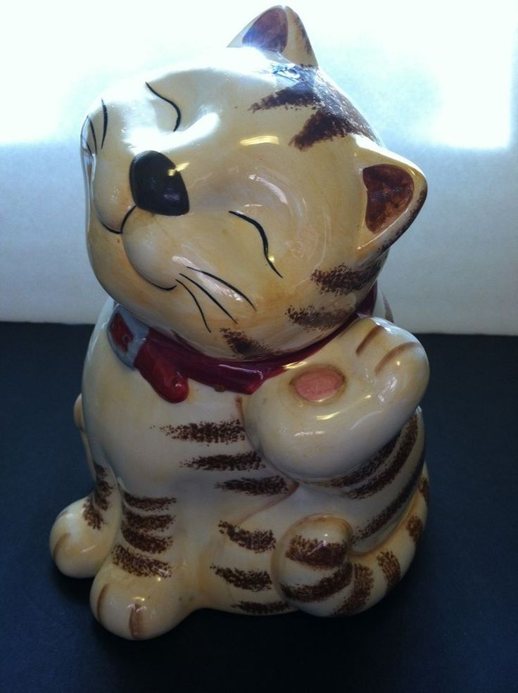 I have the matching salt and pepper shakers to this... Orange / White Tabby Cat Cookie Jar CKA CKAO