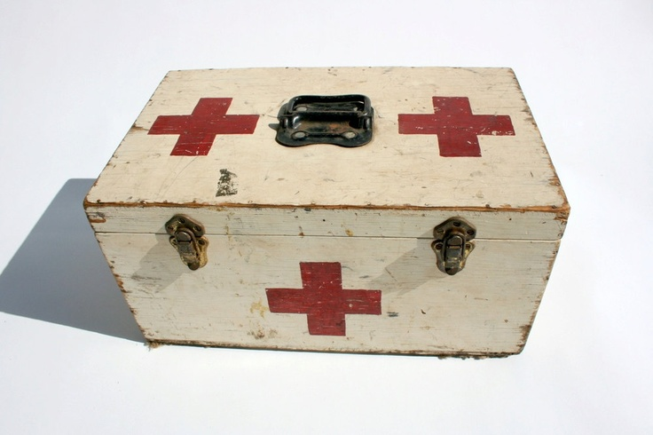Vintage Red Cross first aid box via Etsy.