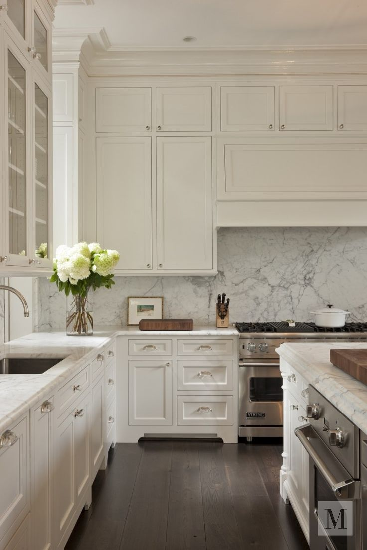 Marble Backsplash And Counters White Cabinets Stainless Appliances