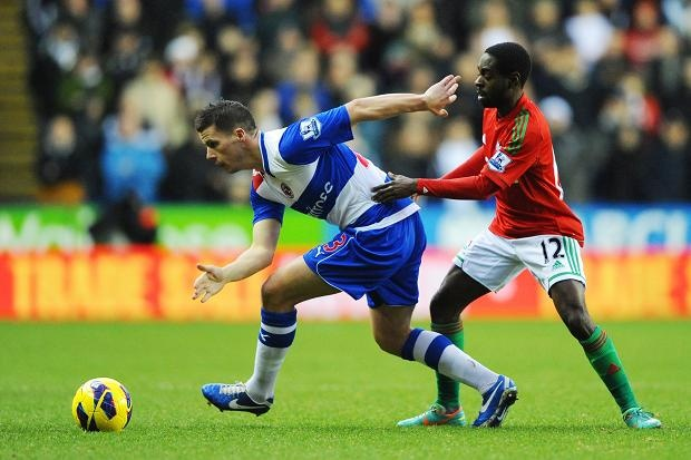 Dec 26 Nathan Dyer put Ian Harte under pressure in the first half at the Madjeski Stadium