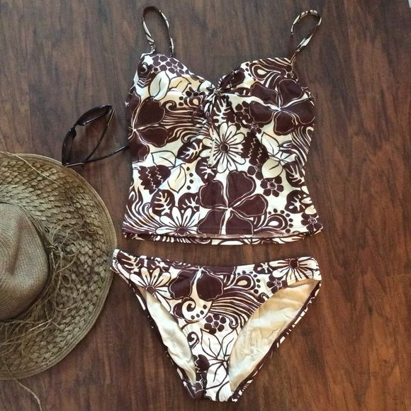 Victoria's Secret brown and cream tankini Excellent used condition. Beautiful brown and cream colors! 34C top with matching size medium bottoms. Victoria's Secret Swim