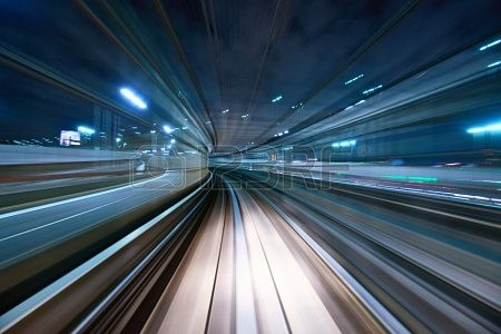Motion blur of a city and tunnel from inside a moving monorail in Tokyo  | Photographer: Sean Pavone #123RF