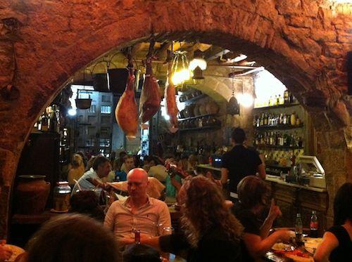 Jamons Hanging at Bodega la Tinaja in Barcelona   Tip for Preparing for Vacation with Kids