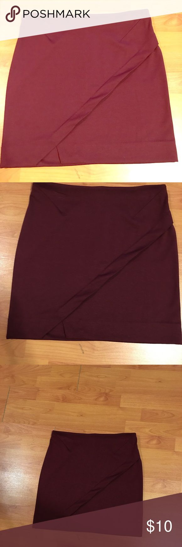 Burgundy mini skirt Perfect fall colored skirt! It can be paired with tights or worn without. I am 5'5 and this skirt comes right above my knees. It can be worn at the office or on a night out. I've worn it only once for a dress up day at work. It has a stain on the inside of the skirt, but not visible on the outside. Metaphor Skirts Mini #nightoutskirt