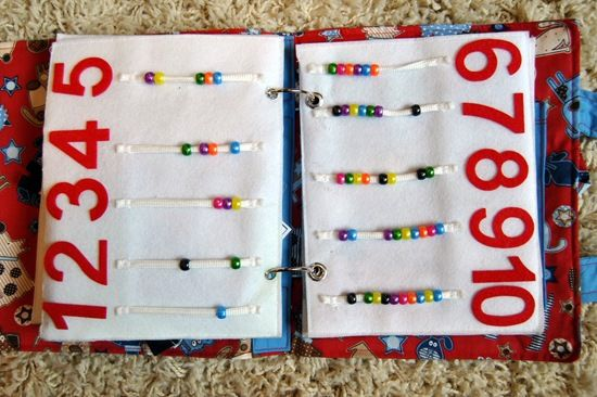 i LOVE this book she made for her son! this is so creative and fun! interactive and learning while playing at its finest! it would be amazing for car trips and since she used ring clips, she could probably have the book grow with her kids. /applause