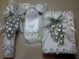Resultado de imagen para vela biblia y rosario para primera comunion